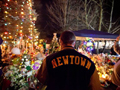 Connecticut School Shooting. Man in newtown jacket mourns