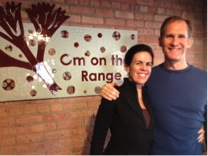Beth and Terry Kiely pose in front of the Om on the Range sign