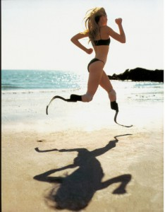 Aimee Mullins running with her prosthetic legs