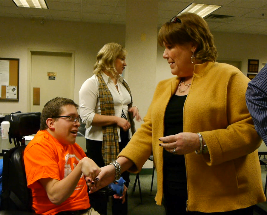 Nick and Joan shake hands