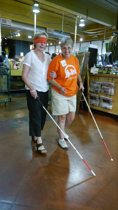 State Representative Robyn Gabel learning Sighted Guiding