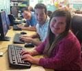 Matt, Brett and Allissa, our Volunterns at their computers at JJ's List