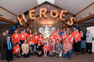 "JJ's List team members posing under balloons that spell ""Heroes"" at the Bridge Builder Benefit 2011"