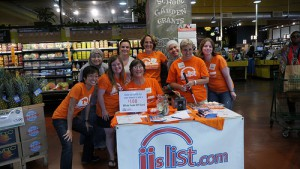 The JJ's List Team posing behind our promo table at Whole Foods Market Evanston South