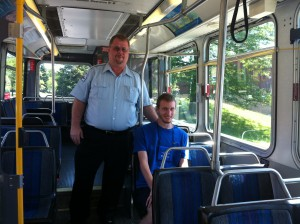 Driver & Passenger On Pace Bus
