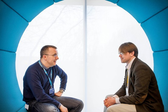 SAP employee Patrick Brophy, right, with his co-worker and coach David Sweeney. Ciaran Dolan for The Wall Street Journal