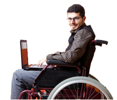 Man who uses wheelchair using a laptop